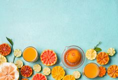 Citrus food background. Variety of citrus fruits and juice on light blue background, top view with copy space. Flat lay. Healthy stock photos