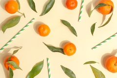 Citrus food on ligth-yellow background - assorted citrus fruits with mint leaves. Top view. Mix lemon orange whole organic lime slice cut half cross collection royalty free stock photography