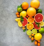 Citrus fresh fruits. On a concrete background royalty free stock photo