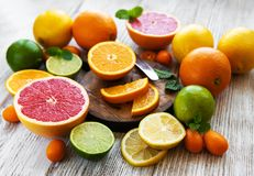 Citrus fresh fruits. On the white wooden table royalty free stock images