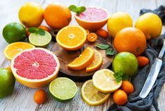Citrus fresh fruits. On the white wooden table stock photo