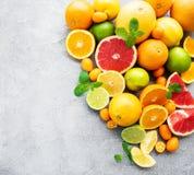 Fresh citrus fruits. Citrus fresh fruits on a concrete background stock photos