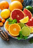 Citrus fresh fruits. Plate with citrus fresh fruits on a concrete background royalty free stock images