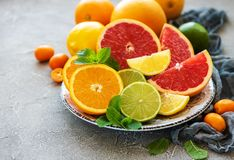 Citrus fresh fruits. Plate with citrus fresh fruits on a concrete background royalty free stock photos