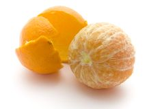 Citrus fruit. An orange citrus fruit rolled out of its skin Stock Images