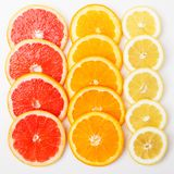 Citrus fruit background. Lemon raw ripe fresh healthy organic natural juicy orange food sweet vitamin yellow nutrition nature peel portion agriculture tropical royalty free stock photo