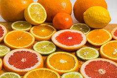 Citrus fruit background with sliced f oranges lemons lime tanger Royalty Free Stock Images