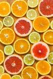 Citrus fruit background with sliced f oranges lemons lime tanger Royalty Free Stock Photos