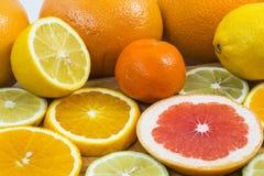 Citrus fruit background with sliced f oranges lemons lime tanger Stock Photography