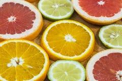Citrus fruit background with sliced f oranges lemons lime tanger Royalty Free Stock Photo