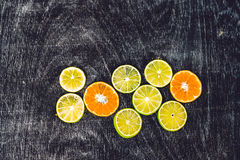 Citrus fruit background with sliced oranges lemons lime tangerines as a symbol of healthy eating and immune system boost with natu Royalty Free Stock Photography