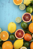 Citrus Fruit on blue wood table. Stock Photos
