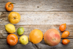 Citrus fruit collection on weathered wood Stock Photos