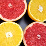Citrus fruit. Cut orange and grapefruit on dark background. Useful vitamin healthy food stock photo