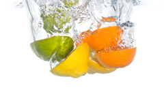 Citrus fruit falling in water Royalty Free Stock Photography
