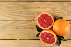 Citrus fruit. Fresh grapefruit with leaves on a natural wooden table. top view. free space stock photography