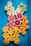 Citrus fruit half cut on vibrant background Stock Image