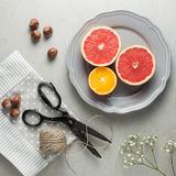 Citrus fruit and hazelnuts as snack Stock Photography