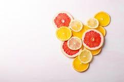Citrus fruit Heart from slices of lemon, orange, grapefruit on white background. Love, healthy, ecology concept. Stock Photo
