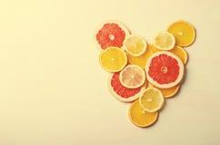 Citrus fruit Heart from slices of lemon, orange, grapefruit on white background. Love, healthy, ecology concept. Stock Photography