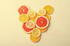 Citrus fruit Heart from slices of lemon, orange, grapefruit on white background. Love, healthy, ecology concept. Stock Photography