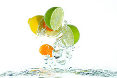 Citrus fruit jumping out of the water royalty free stock photo