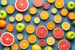 Citrus fruit pattern on grey concrete table. Food background. Healthy eating. Antioxidant, detox, dieting, clean eating royalty free stock image
