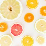 Citrus fruit pattern of lemon, orange, grapefruit, sweetie and pomelo on white background. Flat lay, top view. stock photo