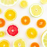Citrus fruit pattern made of lemon, orange, grapefruit, sweetie and pomelo on white background. Juicy concept. Flat lay, top view. Citrus fruit pattern made of stock photo