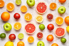 Citrus fruit pattern on white concrete table. Food background. Healthy eating. Antioxidant, detox, dieting, clean eating stock photo