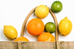 Citrus fruit and shopping bag Royalty Free Stock Photography