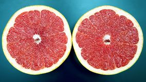 Citrus fruit. Sliced grapefruit on a dark background. Vitamin healthy food stock photography