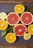 Citrus Fruit Slices. Citrus fruit halves on a slate background Stock Images