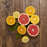 Citrus fruit slices. Citrus halves on a wooden background Stock Image
