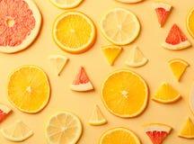 Citrus fruit slices of lemon, orange, grapefruit on yellow background. Stock Photography