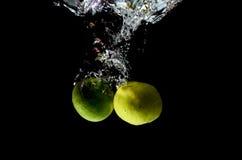 Citrus fruit splashing. 2 lemons throw them into the water Royalty Free Stock Images