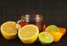 Citrus fruit and tea Stock Photos