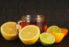 Citrus fruit and tea Stock Photos