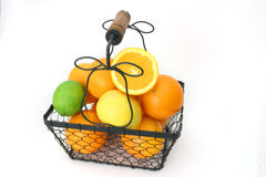 Citrus Fruit In A Wire Basket. Over white Stock Photo
