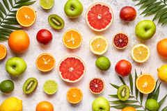 Citrus fruits background mix flat lay, summer healthy vegetarian food, antioxidant detox nutrition diet