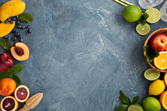 Citrus fruits background with oranges, limes and lemons Stock Images