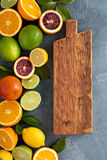 Citrus fruits background with oranges, limes and lemons Stock Photography