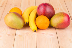Citrus fruits and bananas Stock Images