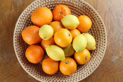 Citrus fruits in a basket Stock Photo