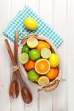 Citrus fruits in basket. Oranges, limes and lemons Stock Photo