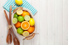 Citrus fruits in basket. Oranges, limes and lemons Royalty Free Stock Photo