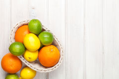 Citrus fruits in basket. Oranges, limes and lemons Royalty Free Stock Image