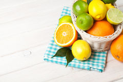 Citrus fruits in basket. Oranges, limes and lemons Royalty Free Stock Photography
