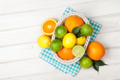 Citrus fruits in basket. Oranges, limes and lemons Royalty Free Stock Images