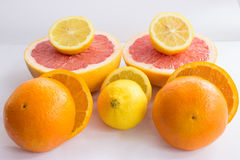 Citrus fruits being cut in half royalty free stock photography